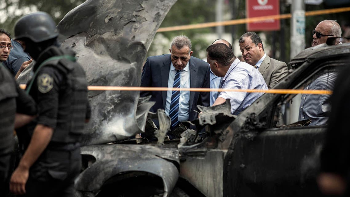 Security personnel investigate the site of a bombing that killed Egypt's top prosecutor, Hisham Barakat, in Cairo, Egypt, Monday, June 29, 2015. AP