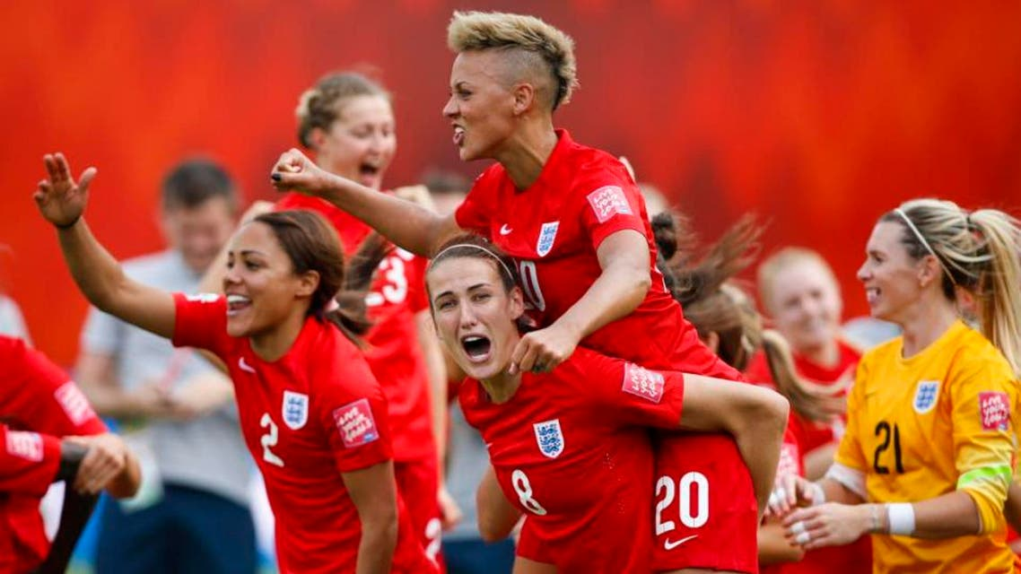 From left to right, England's Alex Scott, Jill Scott, Lianne Sanderson and goalkeeper Carly Telford celebrate after defeating Germany in FIFA Women's World Cup soccer third-place match in Edmonton, Alberta, Canada on Saturday, July 4, 2015. (Jeff McIntosh/The Canadian Press via AP) MANDATORY CREDIT