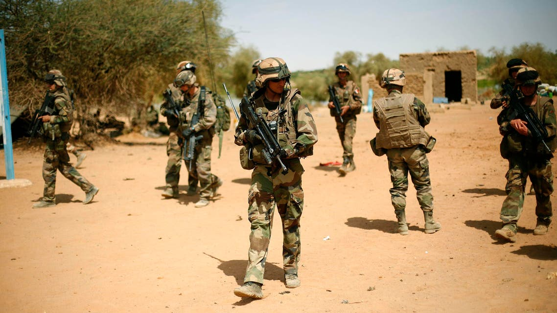 In this Feb.10, 2013 file photo, French soldiers secure the area where a suicide bomber attacked, at the entrance of Gao, northern Mali. AP
