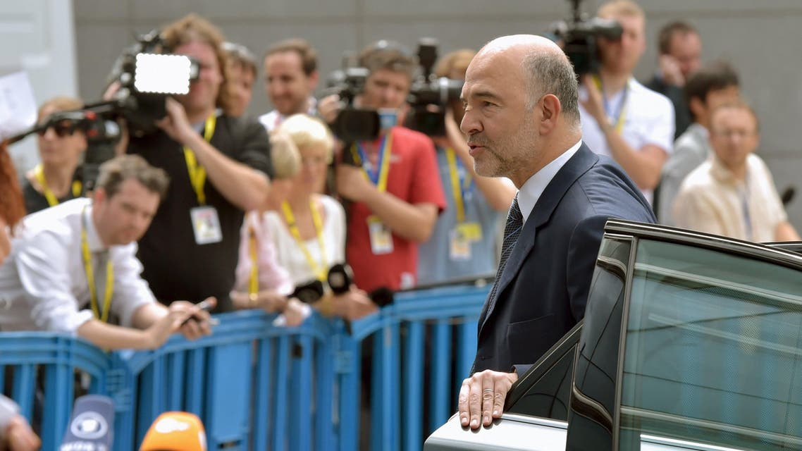 European Commissioner for Economic and Financial Affairs, Taxation and Customs Pierre Moscovici arrives at a euro zone finance ministers meeting on the situation in Greece in Brussels, Belgium, July 7, 2015. REUTERS