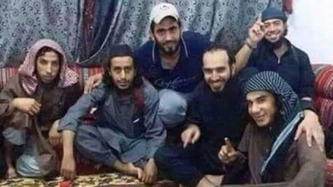 ISIS militants pose next to an iftar meal (Twitter)