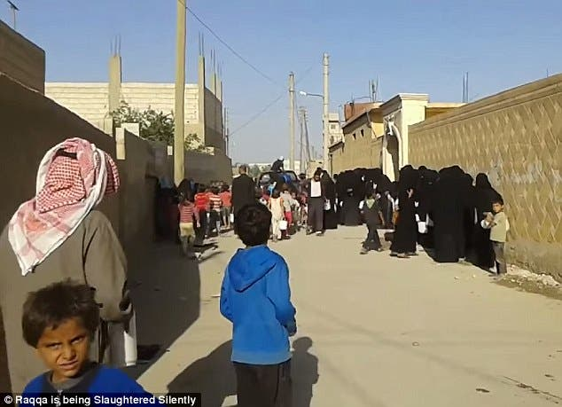 Iraqi women and children apparently queue for food and water (Photo courtesy of social media)