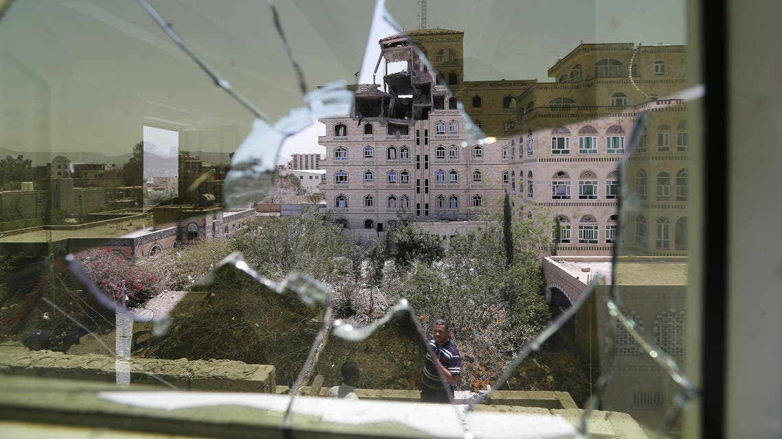 Damage in the building of the Houthi movement's politburo is seen through a broken window of an adjacent house. (File photo: Reuters)