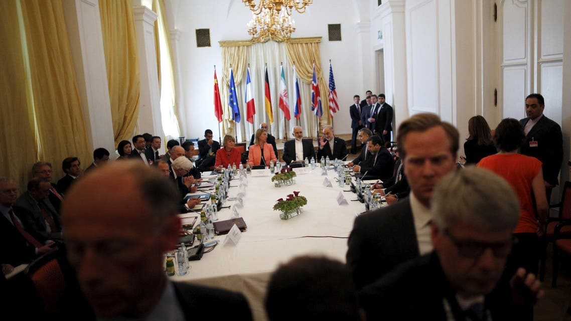 Iranian Foreign Minister Zarif sits next to EU High Representative for Foreign Affairs and Security Policy Mogherini as they meet with foreign ministers at the hotel where the Iran nuclear talks meetings are being held in Vienna. (Reuters)