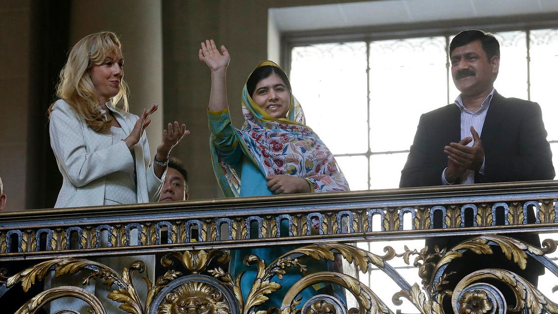 Nobel Peace Prize recipient Malala Yousafzai, center, waves while introduced at a ceremony for the 70th anniversary of the United Nations in San Francisco, Friday, June 26, 2015.