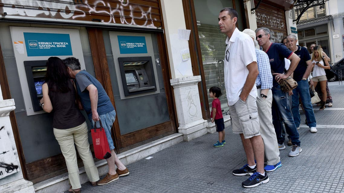People stand in queue to use an ATM in the northern Greek port city of Thessaloniki, Thursday, July 9, 2015.  AP