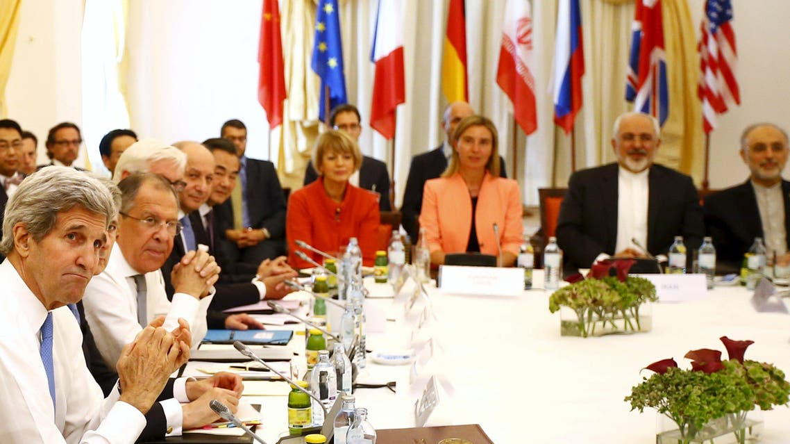Iranian Foreign Minister Zarif sits next to European Union High Representative for Foreign Affairs Mogherini as they meet with foreign ministers from the U.S., France, Russia, Germany, China and Britain in Vienna. (Reuters)