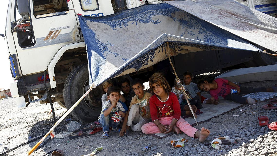 Syrian refugee children from the northern Syrian town of Tel Abyad sit under a make shift tent pitched up next to a truck in Akcakale, in Sanliurfa province, Turkey, June 18, 2015. Reuters