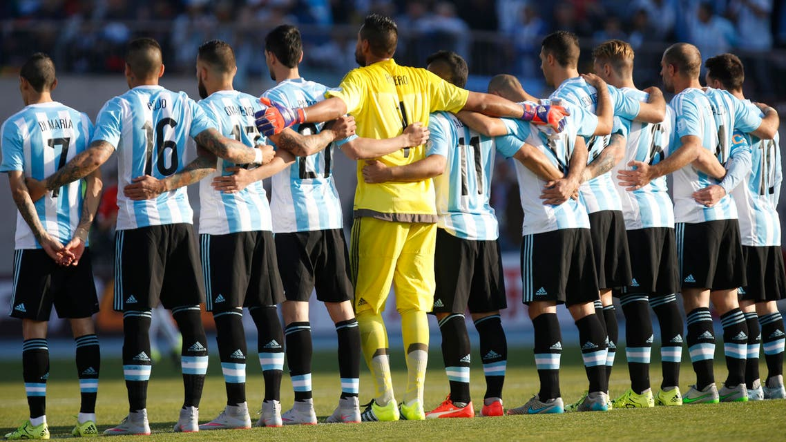 Argentina's players embrace during a minute of silence in remembrance of Chilean motorcycle pilot Carlos de Gavardo, before the Copa America final soccer match against Chile at the National Stadium in Santiago, Chile, Saturday, July 4, 2015. (AP Photo/Luis Hidalgo)