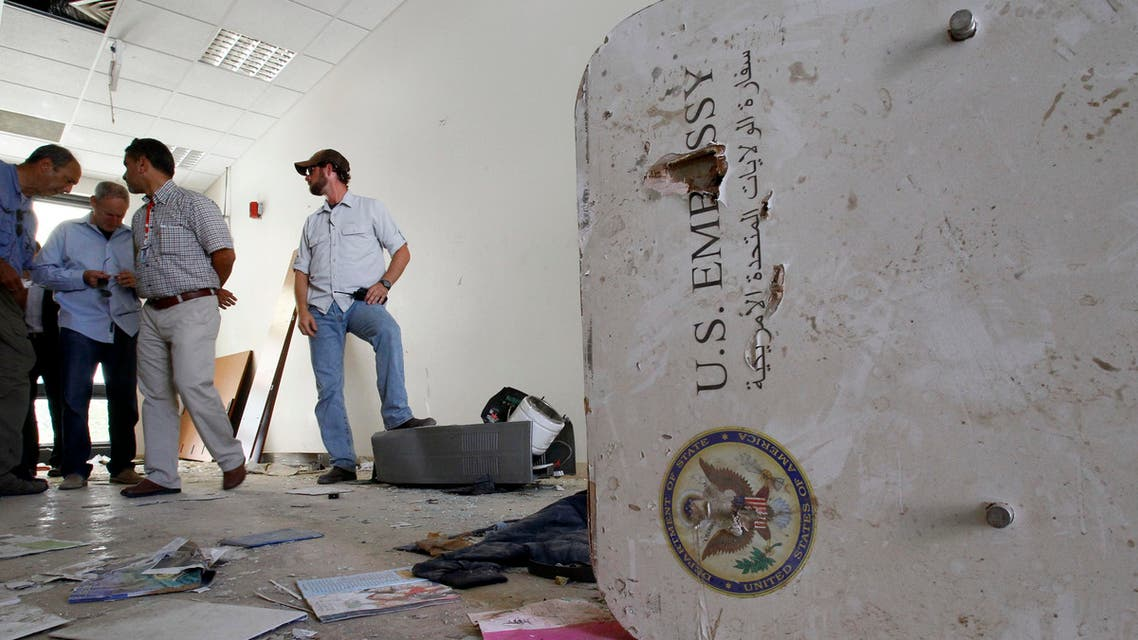 A U.S. embassy emblem is seen on a broken door during a visit for the press in the vandalized U.S. Embassy in Tripoli, Libya, Monday, Sept. 12, 2011. (File Photo: AP)