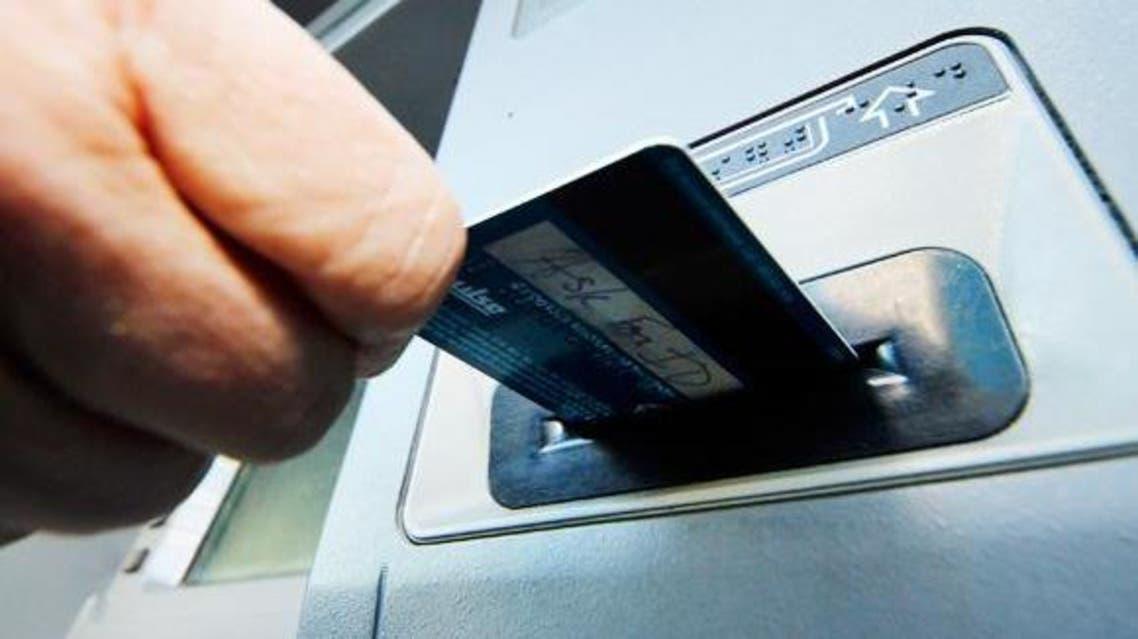 ATM card into slot. (AP from http://www.arabnews.com/saudi-arabia/news/760651)