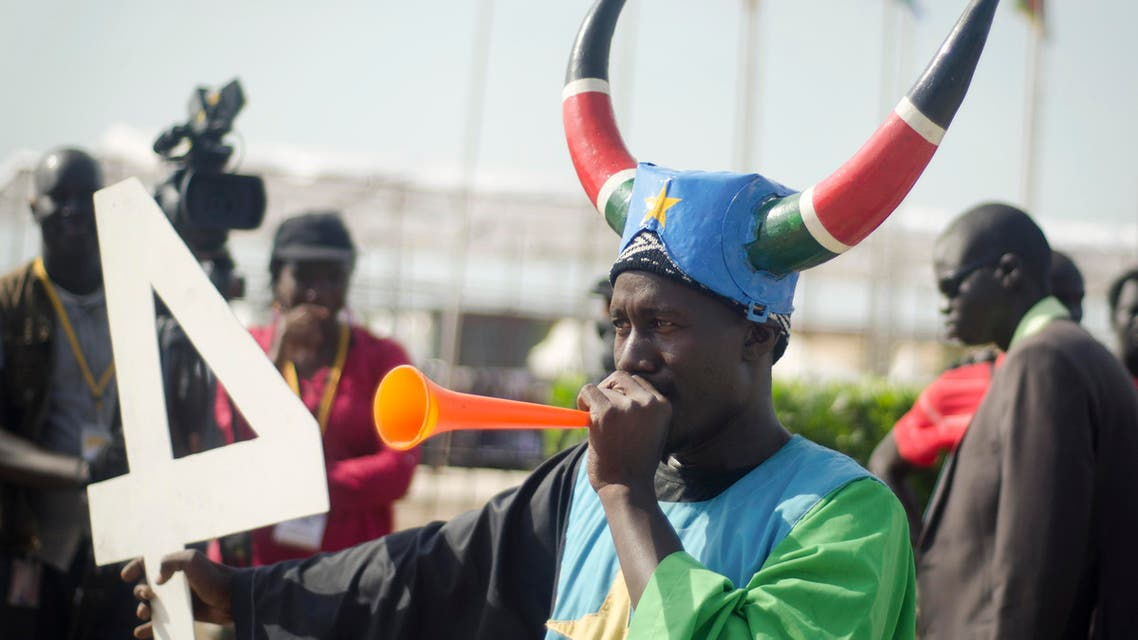 A South Sudanese man blows a horn as he attends an independence day ceremony in the capital Juba, South Sudan, Thursday, July 9, 2015. AP