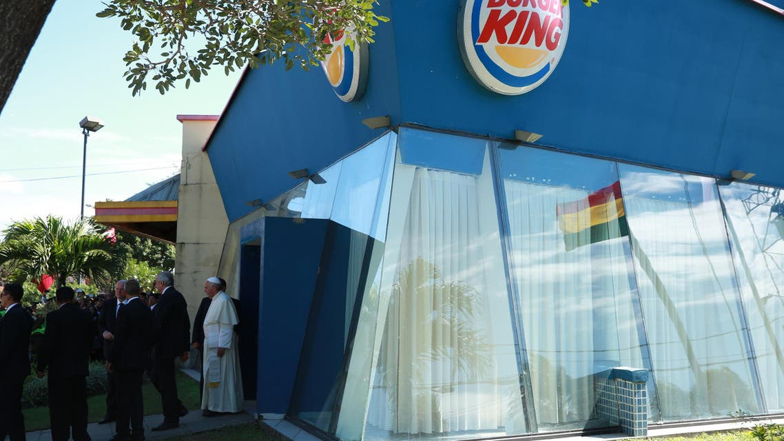 Pope Francis stands in front of a Burger King restaurant at the Christ the Redeemer square in Santa Cruz, Bolivia, Thursday, July 9, 2015. (AP)