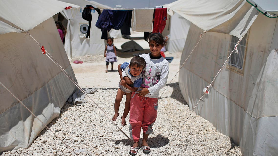 Syrian refugee children play at a refugee camp in Suruc, on the Turkey-Syria border, Friday, June 19, 2015. Ahead of World Refugee Day on Saturday, June 20, 2015, the UN refugee agency, UNHCR, estimated that a total of 11.6 million people from Syria had been displaced by the conflict by the end of last year, the largest such figure worldwide. Turkey is the world's biggest refugee host with 1.59 million refugees, according to the most recent U.N. figures. (AP Photo/Emrah Gurel)