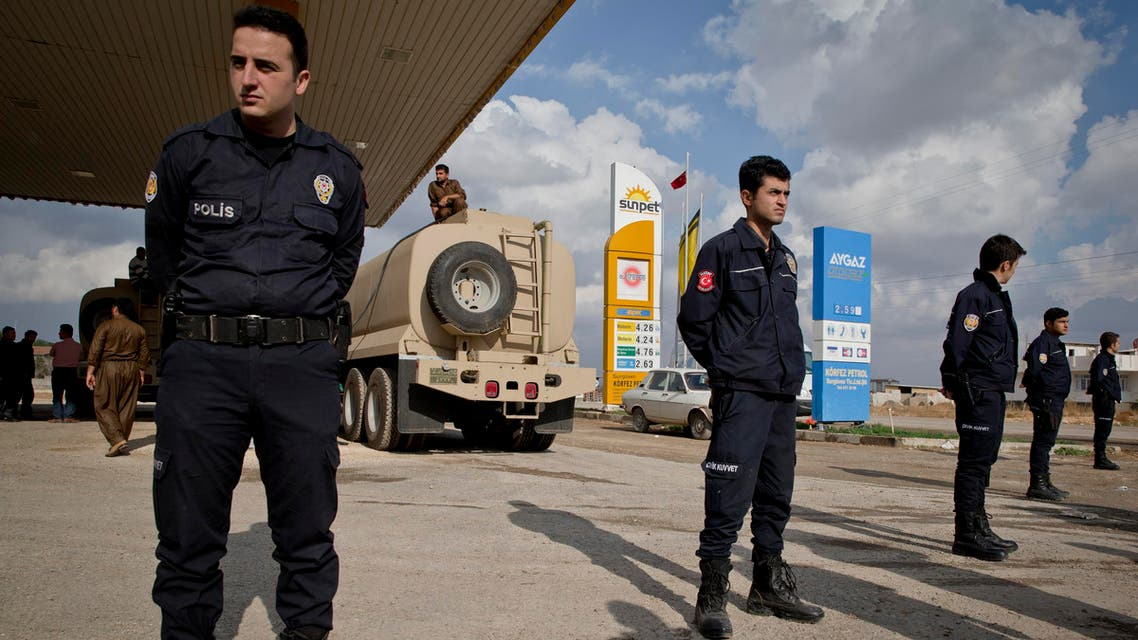 Turkish police officers stands guard outside a staging area on the outskirts of Suruc, near the Turkey-Syria border. (File: AP)