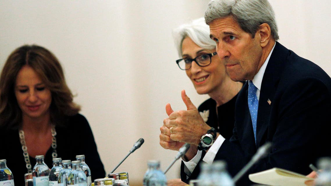 """U.S. Secretary of State John Kerry and U.S. Under Secretary for Political Affairs Wendy Sherman, centre, meet with foreign ministers and representatives of Germany, France, China, Britain, Russia and the European Union during the current round of nuclear talks with Iran, being held in Vienna, Austria July 10, 2015. U.S. Secretary of State John Kerry urged Iran to make the """"tough political decisions"""" needed to reach an agreement but Iranian Foreign Minister Mohammad Javad Zarif accused major powers on Friday of backtracking on previous pledges and throwing up new """"red lines"""" at nuclear talks. (Carlos Barria/Pool via AP)"""
