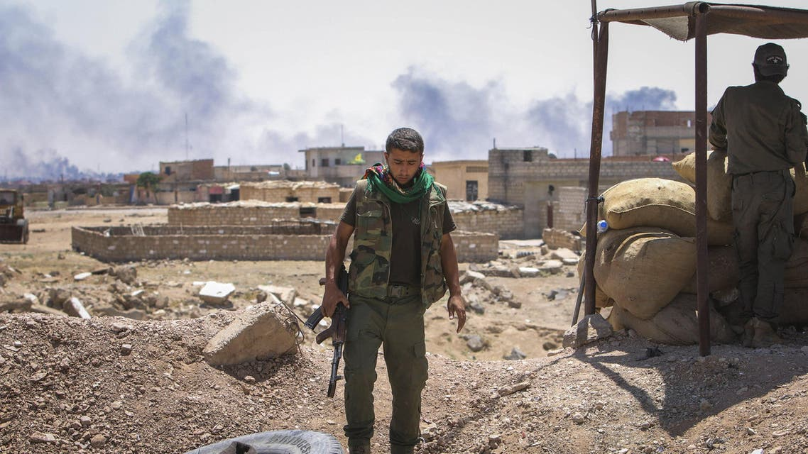 Members of the Kurdish Security Forces (Asayish) stand east of Hasaka city as smoke rises from what activists said were airstrikes by forces loyal to Syria's President Bashar al-Assad on locations controlled by ISIS. (File: Reuters)