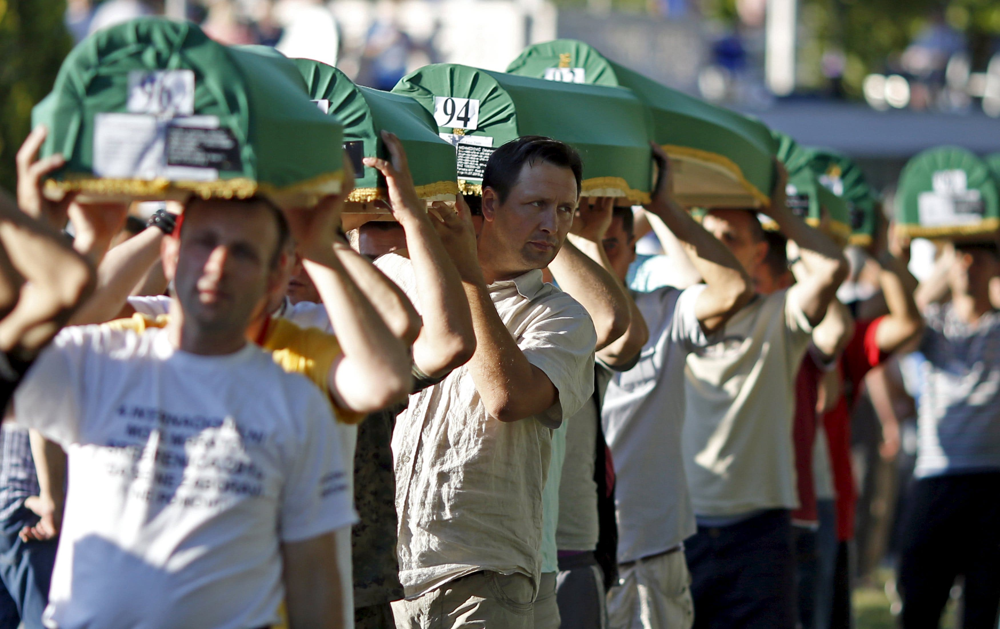 Bosnian Muslims carry coffins of their relatives who were victims of the 1995 Srebrenica massacre, at the Memorial Centre in Potocari, Bosnia and Herzegovina July 10, 2015. (Reuters)
