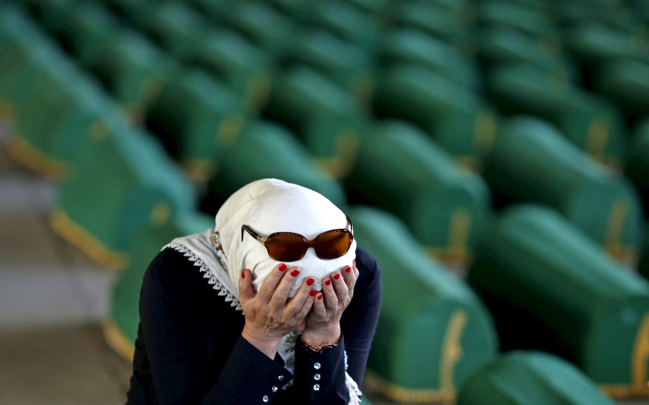 woman cries near the coffins of victims of the 1995 Srebrenica massacr in Potocari, Bosnia and Herzegovinain Memorial center Potocari, Bosnia and Herzegovina July 10, 2015. (Reuters)