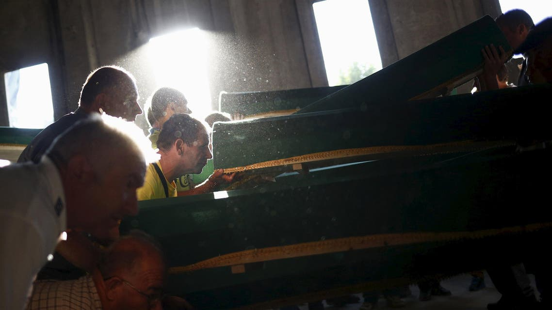 Men lift coffins containing the bodies of newly identified victims of the 1995 Srebrenica massacre at the Memorial Center in Potocari near Srebrenica, Bosnia and Herzegovina. (Reuters)