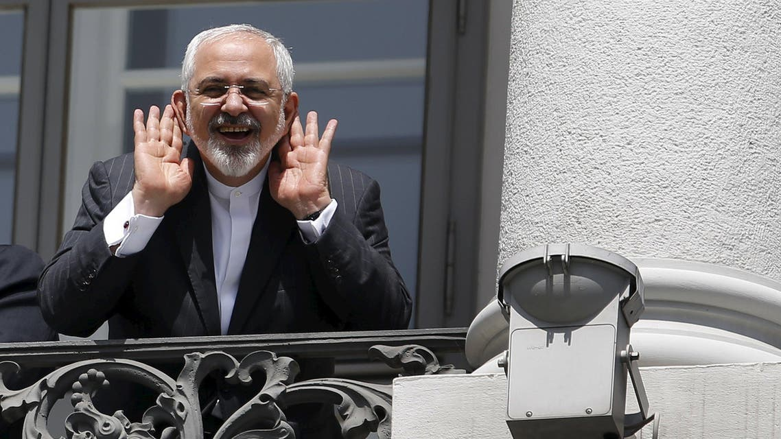 Iranian FM Mohammad Javad Zarif gestures as he talks to journalist from a balcony of the Palais Coburg hotel where the Iran nuclear talks are being held in Vienna. (File: Reuters)