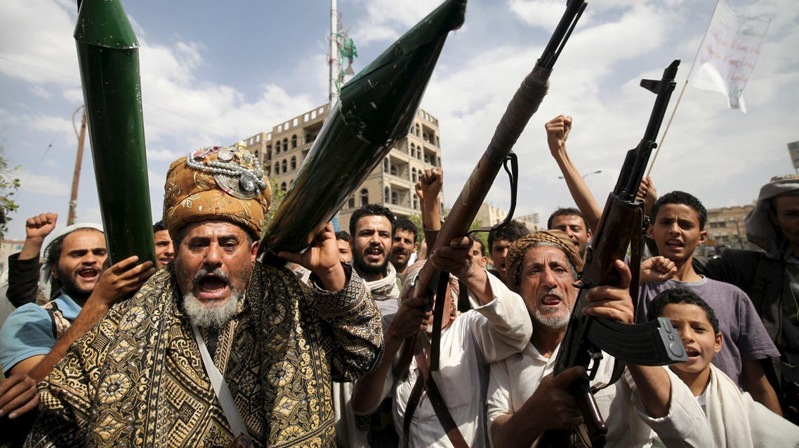 Houthi followers hold mock missiles and their rifles as they shout slogans during a demonstration against the United Nations in Sanaa. (File: Reuters)