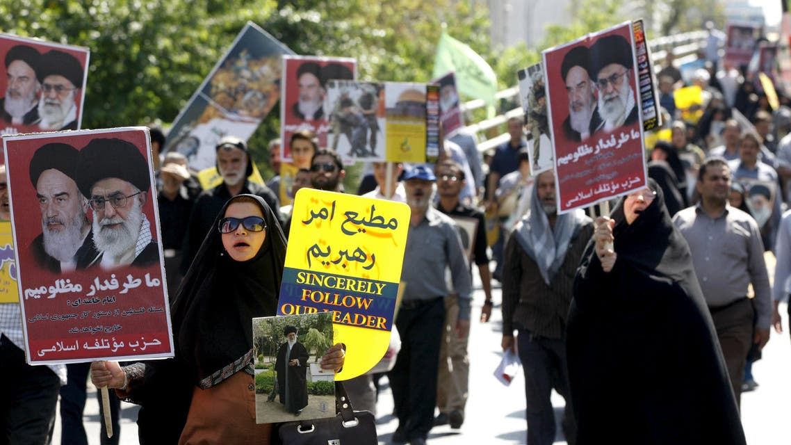 Iranian demonstrators carry posters depicting Iran's Supreme Leader Ayatollah Ali Khamenei and late Iranian leader Ayatollah Khomeini during a rally marking al-Quds (Jerusalem) Day in Tehran July 10, 2015. REUTERS