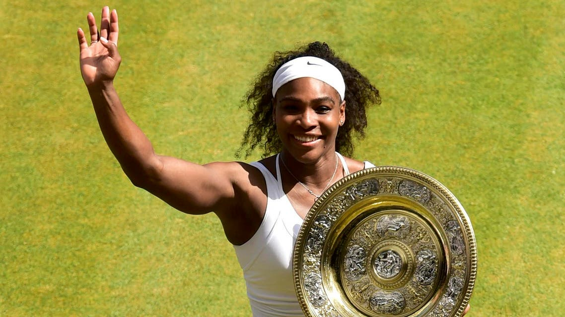 Serena Williams of the U.S.A celebrates with the trophy after winning her Women's Final match against Garbine Muguruza of Spain at the Wimbledon Tennis Championships in London, July 11, 2015.  reuters