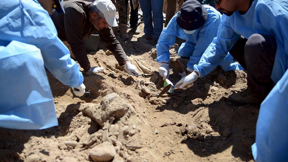 Forensic workers search for the remains of bodies belonging to Shi'ite soldiers from Camp Speicher who were killed by Islamic State militants. (File: Reuters)