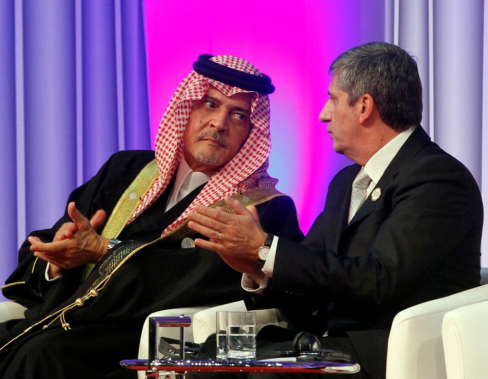 Saudi Arabia's late former Foreign Minister Prince Saud al-Faisal, left, talks with Michael Spindelegger, right, Foreign Minister of Austria in Austria. (AP)
