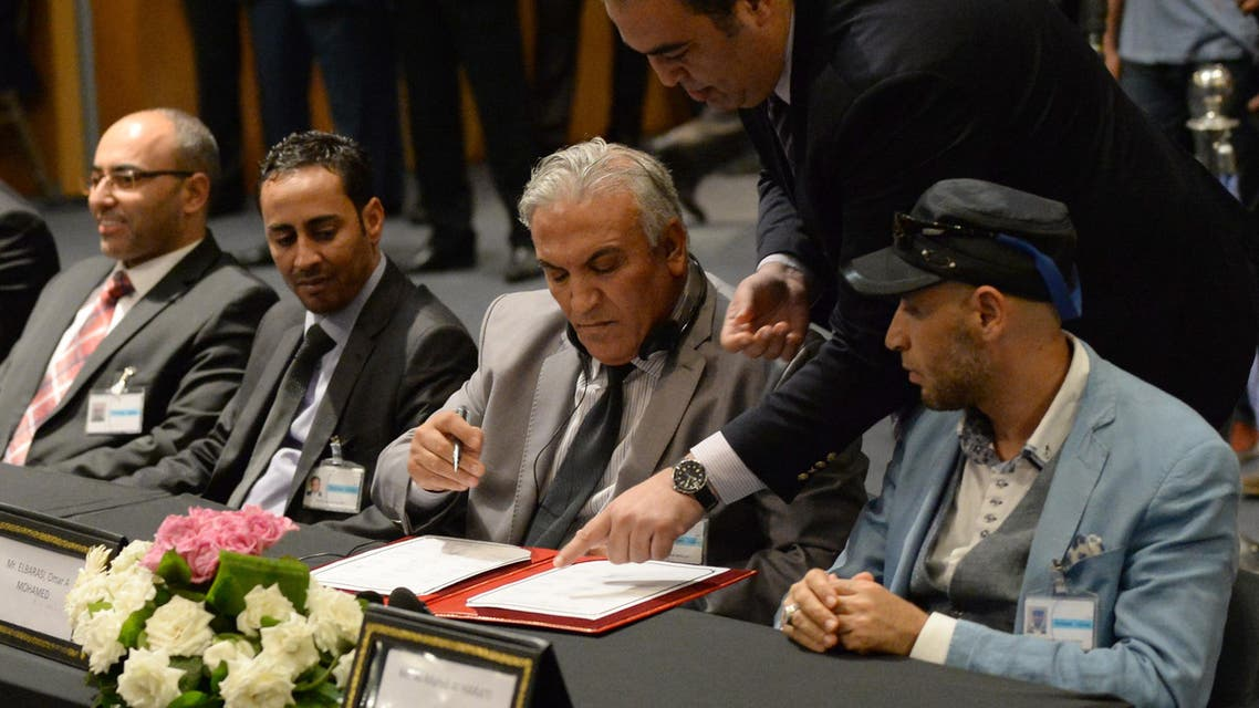Members of the delegation from the government in the eastern city of Tobruk sign the document on a new version of a U.N.-brokered peace deal. (File: AFP)
