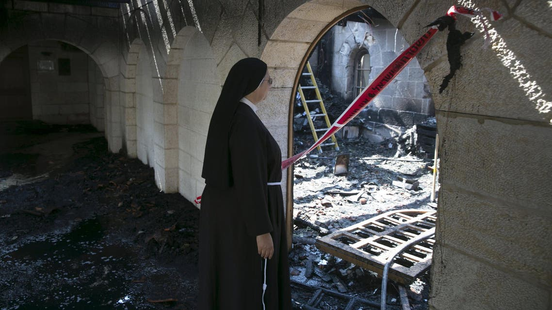 A nun looks at damage caused by a fire in the Church of Loaves and Fishes on the shores of the Sea of Galilee in northern Israel. (File: Reuters)