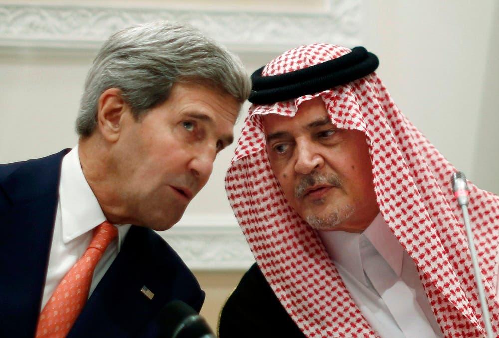 U.S. Secretary of State John Kerry, left, speaks with the late Saudi Arabia's Foreign Minister Prince Saud al-Faisal in Riyadh. (AP)