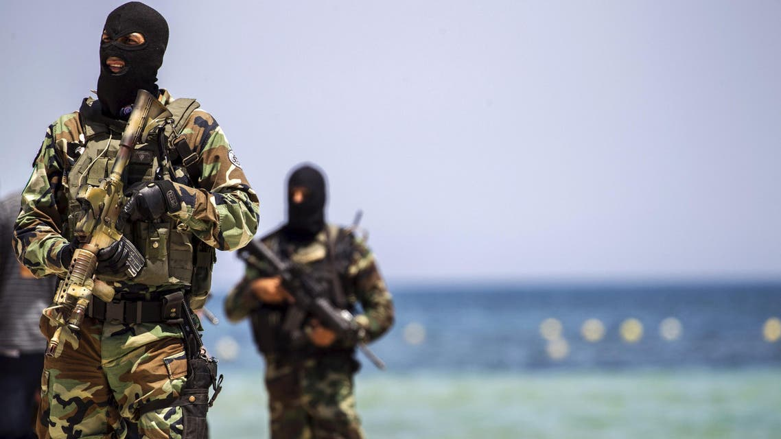 Tunisia's special forces secure the beachside of the Imperial Marhaba resort, while British, French, German and Tunisia's interior minister arrive to pay their tribute in front of a makeshift memorial in Sousse, Tunisia, June 29, 2015. R
