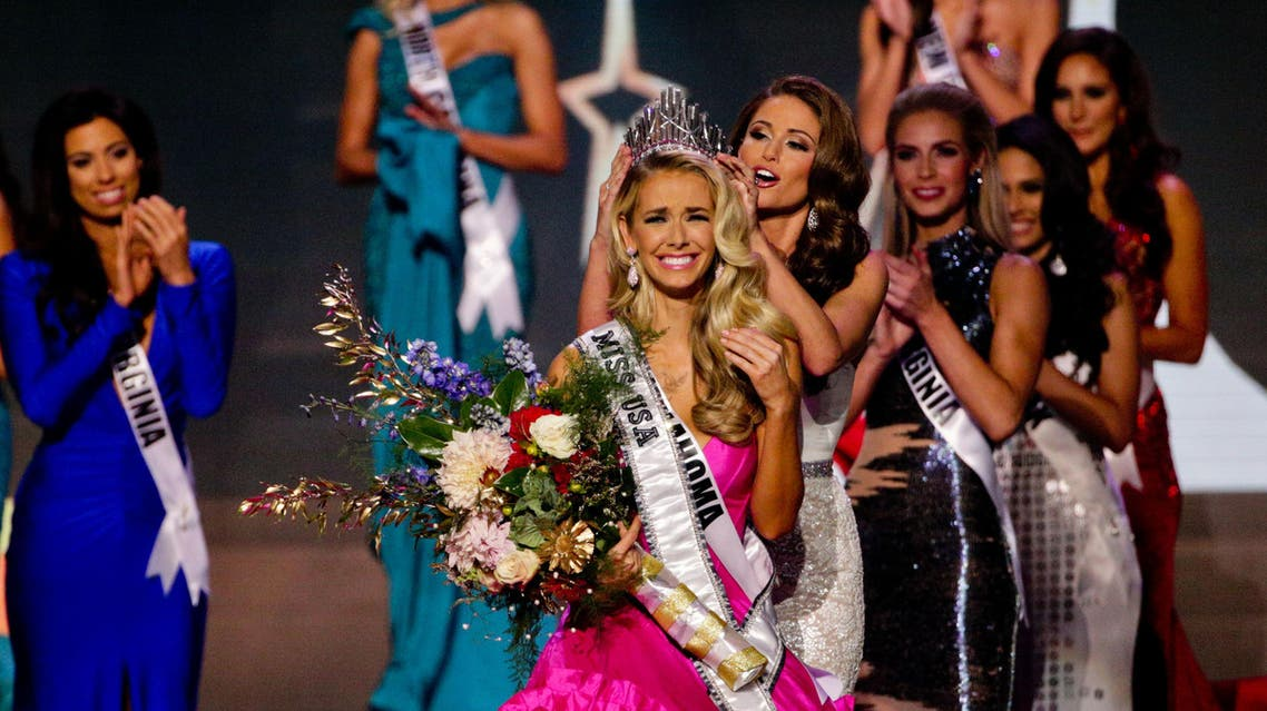Miss Oklahoma Olivia Jordan is crowned Miss USA by Miss USA 2014 Nia Sanchez during the 2015 Miss USA pageant in Baton Rouge, La., Sunday, July 12, 2015. (AP)