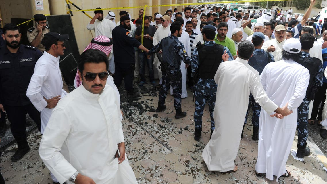 Security forces, officials and civilians gather after a deadly blast claimed by the Islamic State group that struck worshippers attending Friday prayers at a Shiite mosque in Kuwait City, Friday, June 26, 2015. Friday's explosion struck the Imam Sadiq Mosque in the neighborhood of al-Sawabir, a residential and shopping district of the capital. (AP Photo)