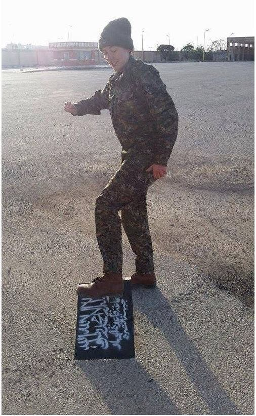 A photo reportedly shows Rosenberg stomping on the ISIS flag. (Photo courtesy: Haaretz)