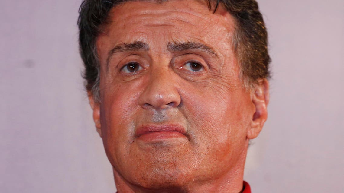"""U.S. actor Sylvester Stallone attends the Macau premiere of his movie """"The Expendables 3"""" in Macau, China, Friday, Aug. 22, 2014. (AP Photo/Kin Cheung)"""