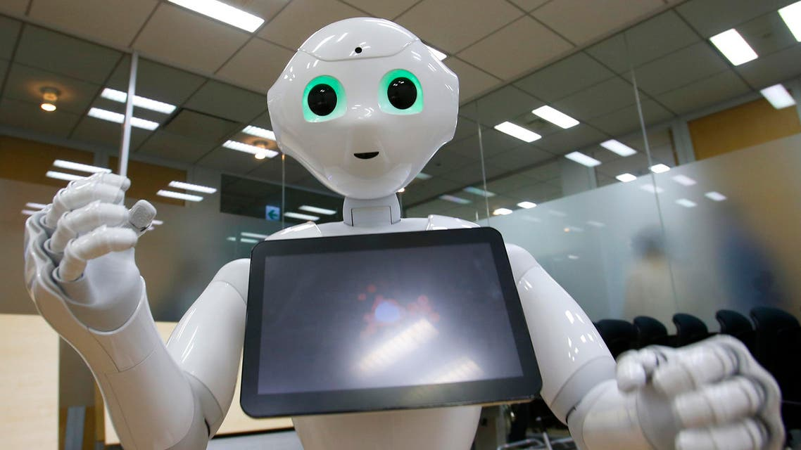 SoftBank Corp.'s new companion robot Pepper performs during an interview at the technology company's headquarters in Tokyo. (AP)