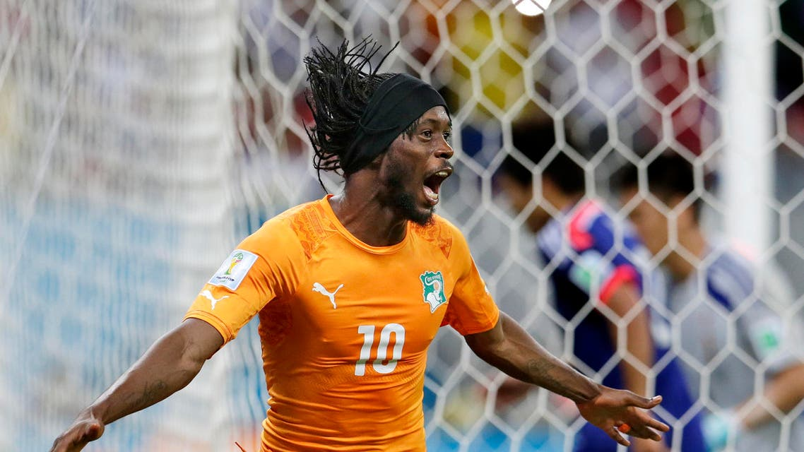 Ivory Coast's Gervinho celebrates scoring his side's second goal against Japan during the group C World Cup soccer match at the Arena Pernambuco in Recife, Brazil, Saturday, June 14, 2014. (AP)