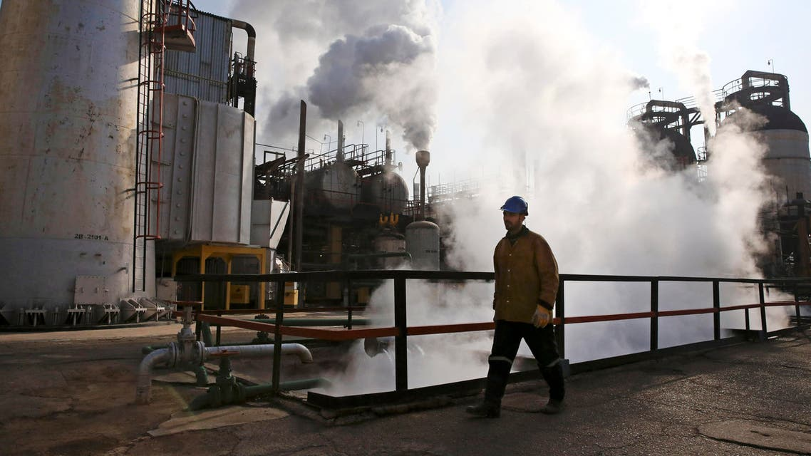 An Iranian oil worker walks at Tehran's oil refinery south of the capital in Iran. (File: AP)