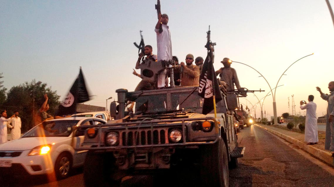 In this file photo taken Monday, June 23, 2014, fighters from the ISIS parade in a commandeered Iraqi security forces armored vehicle. (AP)