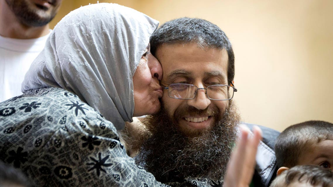 Palestinian Khader Adnan is greeted by Palestinians after his release from an Israeli prison in the West Bank village of Arrabeh near Jenin, Sunday, July 12, 2015.AP