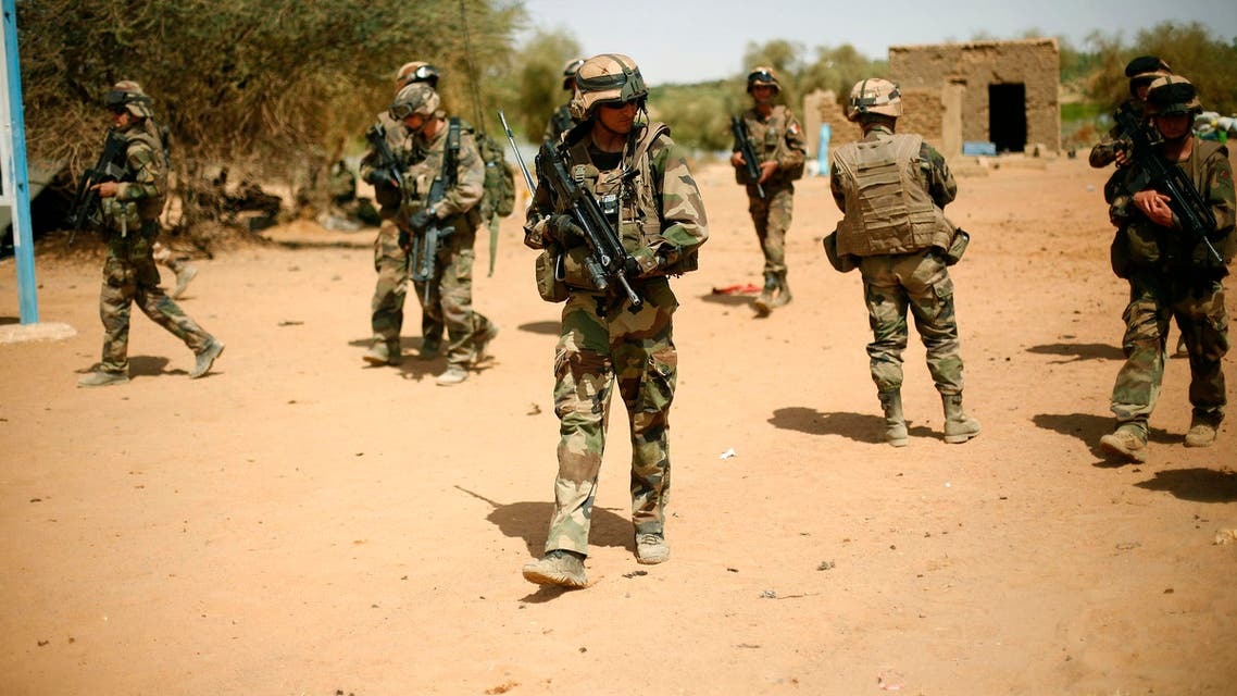 In this Feb.10, 2013 file photo, French soldiers secure the area where a suicide bomber attacked, at the entrance of Gao, northern Mali. Eighteen months after France sent troops to Mali for what was meant to be a targeted operation against extremists, they are still there. And instead of leaving, they're about to expand their mission to fighting terrorism from the Atlantic coast to the Mediterranean. (AP Photo/Jerome Delay, File)