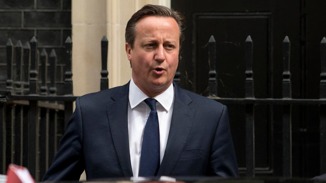 British Prime Minister David Cameron leaves 10 Downing Street in London, prior to the budget being unveiled at the Houses of Parliament, Wednesday, July 8, 2015. (AP)