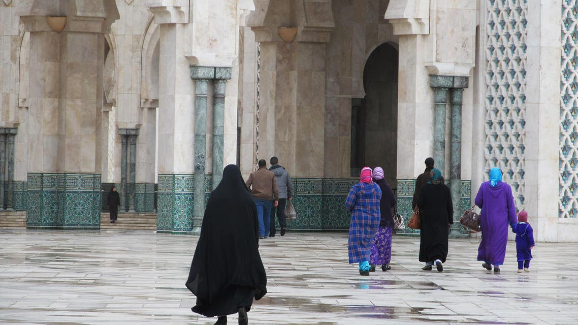 This January 2013 photo shows women about to enter Casablanca's monumental Hassan II mosque in Morocco.