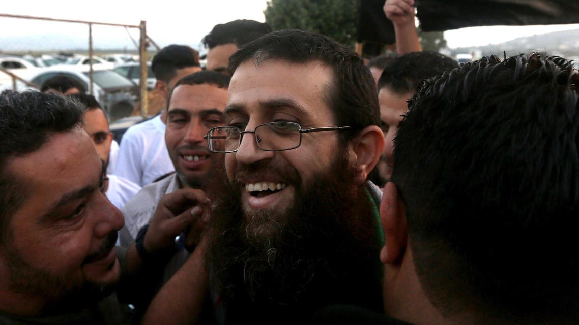 """A file picture taken on July 12, 2015 shows Khader Adnan (C), a Palestinian prisoner who staged a 56-day hunger strike while being detained for a year without charge by Israeli authorities, being greeted by friends and relatives as he arrives in the West Bank village of Arraba after his release. Israeli police on July 13, 2015 re-arrested Adnan a day after he was freed following a 56-day hunger strike that brought him near death, a police spokeswoman said. """"Khader Adnan was arrested because he had no right to be in the Old City of Jerusalem where free access is allowed to West Bank Palestinians only aged 50 and above, and he is just 37,"""" Luba Samri told AFP. AFP PHOTO / JAAFAR ASHTIYEH"""