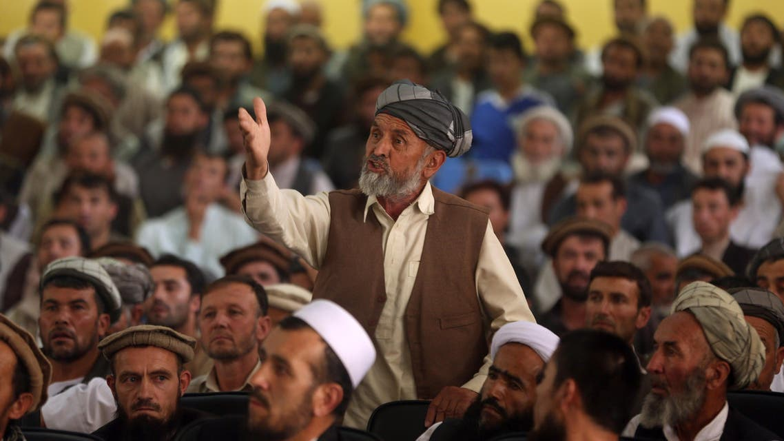 An Afghan elder, center, speaks to Afghanistan's Chief Executive, Abdullah Abdullah, during the leader's visit to Faizabad, the capital of Badakhshan province, Afghanistan, Sunday, July 13, 2015. AP
