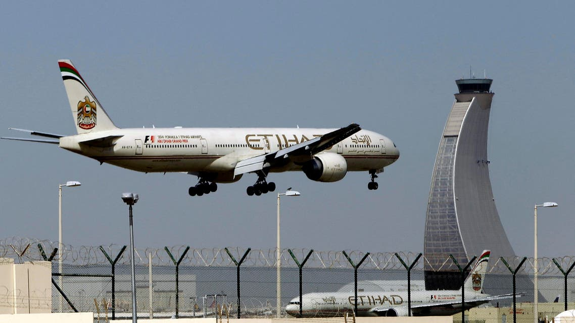 In this May 4, 2014 file photo, an Etihad Airways plane prepares to land at the Abu Dhabi airport in the United Arab Emirates.  (AP)
