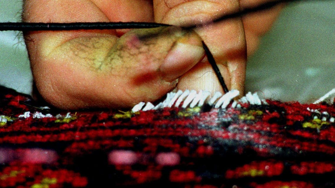 A Cypriot drug enforcement officer gently removes a thread from a hand made Persian carpet containing heroin in Nicosia Thursday, February 3, 2000. Three Persian rugs containing a total of four kilos of the drug were discovered Wednesday by Cypriot custom officers in Larnaca, Cyprus in the suitcase of 35-year old Iranian Fereiboon Batelani from Tehran who was traveling with his wife and five-year old son. (AP Photo/Philip Mark)